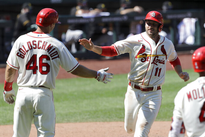 St. Louis Cardinals' Paul DeJong (11) celebrates with Paul Goldschmidt (46) after both players scored on a double by Matt Carpenter during the eighth inning of a baseball game against the Pittsburgh Pirates Saturday, July 25, 2020, in St. Louis. The Cardinals won 9-1. (AP Photo/Jeff Roberson)
