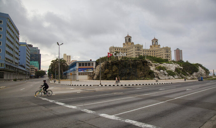 Hotel Nacional stands tall near the empty intersection of 23rd Street and the Malecon seawall, amid a lockdown to curb the spread of COVID-19 in Havana, Cuba, Saturday, June 20, 2020. Like other Caribbean islands, Cuba is highly dependent on tourism. It also earns hard currency from the export of medical and other professional services, remittances, and subsidized petroleum from Venezuela. (AP Photo/Ismael Francisco)