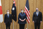 Japanese Prime Minister Yoshihide Suga, left, Australia Foreign Minister Marise Payne, center, and U.S. Secretary of State Mike Pompeo pose for a picture before a four Indo-Pacific nations' foreign ministers meeting at the prime minister's office in Tokyo Tuesday, Oct. 6, 2020. (Nicolas Datiche/Pool Photo via AP)