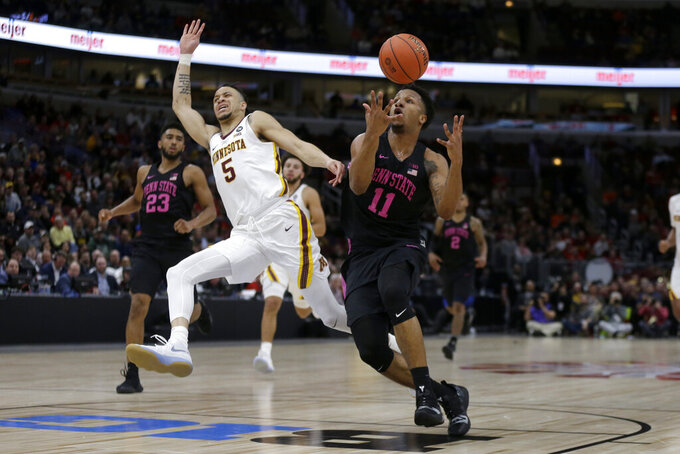 Penn State's Lamar Stevens (11) drivers against Minnesota's Amir Coffey (5) during the second half of an NCAA college basketball game in the second round of the Big Ten Conference tournament, Thursday, March 14, 2019, in Chicago. (AP Photo/Kiichiro Sato)
