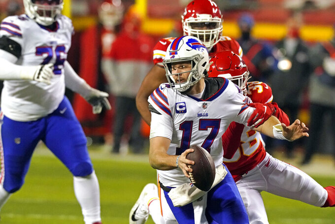 Buffalo Bills quarterback Josh Allen (17) is sacked by Kansas City Chiefs safety L'Jarius Sneed (38) during the first half of the AFC championship NFL football game, Sunday, Jan. 24, 2021, in Kansas City, Mo. (AP Photo/Charlie Riedel)