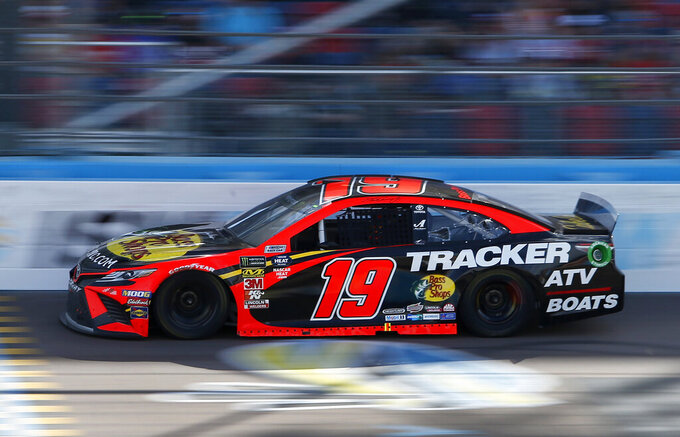 Martin Truex Jr. drives during the NASCAR Cup Series auto race at ISM Raceway, Sunday, March 10, 2019, in Avondale, Ariz. (AP Photo/Ralph Freso)