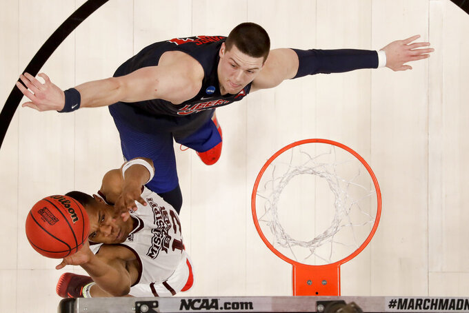 Mississippi State guard Robert Woodard shoots past Liberty forward Scottie James during the first half a first-round game in the NCAA men's college basketball tournament Friday, March 22, 2019, in San Jose, Calif. (AP Photo/Ben Margot)