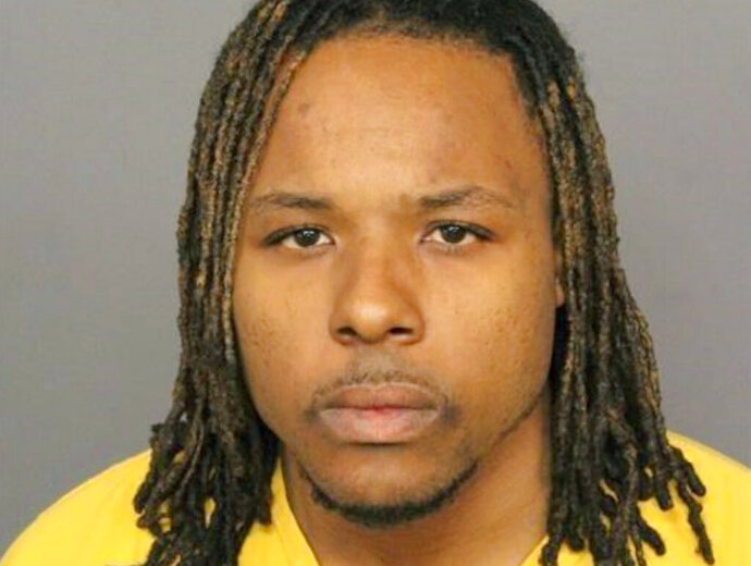 FILE - This file booking image provided by the Denver Police Department shows Michael Hancock.  A jury on Thursday, Oct. 10, 2019 found Hancock, an Uber driver, not guilty of murder in the fatal shooting of a passenger he said attacked him while driving on a freeway in Denver in June 2018. Jurors sided with Hancock, 31, who argued that he was defending himself against passenger Hyun Kim.  (Denver Police Department via AP, File)
