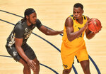 West Virginia forward Oscar Tshiebwe (34) protects the ball from Iowa State forward Solomon Young (33) during the first half of an NCAA college basketball game in Morgantown, W.V., Friday, Dec. 18, 2020. (William Wotring/The Dominion-Post via AP)