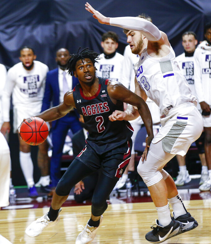 New Mexico State's Donnie Tillman (2) drives to the basket against Grand Canyon's Asbjørn Midtgaard (33) during the first half of an NCAA college basketball game for the championship of the Western Athletic Conference men's tournament Saturday, March 13, 2021, in Las Vegas. (AP Photo/Chase Stevens)