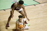 Richmond guard Jacob Gilyard goes to floor for a loose ball as Mississippi State forward Derek Fountain stands over him during the second half of an NCAA college basketball game in the semifinals of the NIT, Thursday, March 25, 2021, in Denton, Texas. (AP Photo/Ron Jenkins)