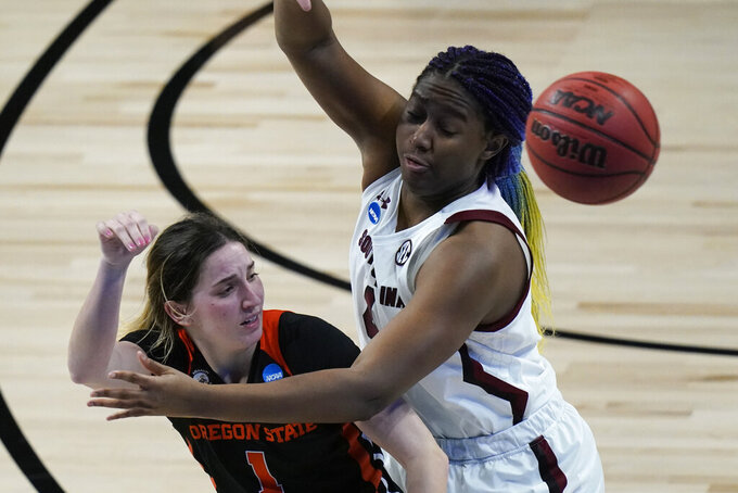 Oregon State guard Aleah Goodman, left, passes around South Carolina forward Aliyah Boston, right, during the second half of a college basketball game in the second round of the women's NCAA tournament at the Alamodome in San Antonio, Tuesday, March 23, 2021. (AP Photo/Eric Gay)