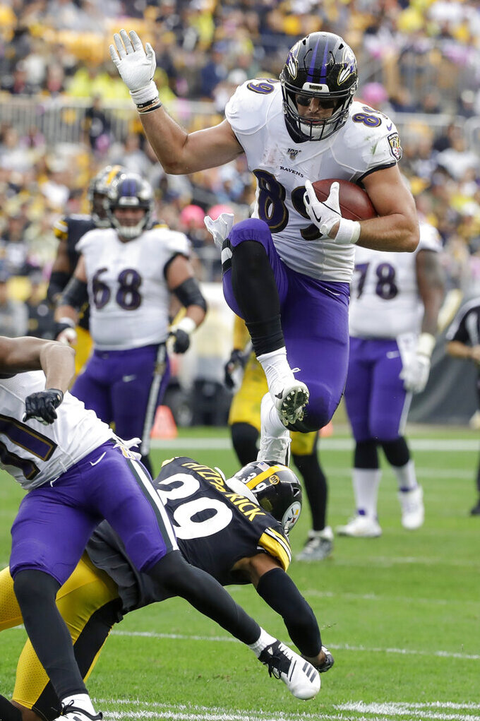 Baltimore Ravens tight end Mark Andrews (89) leaps over Pittsburgh Steelers free safety Minkah Fitzpatrick (39) while running after making a catch in the first half of an NFL football game Sunday, Oct. 6, 2019, in Pittsburgh. (AP Photo/Don Wright)