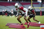 Arizona Cardinals linebacker Isaiah Simmons (9) and Cardinals middle linebacker Jordan Hicks, right, work on technique drills during NFL football training camp practice at State Farm Stadium, Friday, July 30, 2021, in Glendale, Ariz. (AP Photo/Ross D. Franklin)