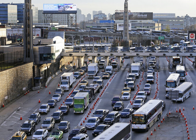 FILE - This photo from Tuesday Nov. 21, 2017, shows traffic going to New York City at the entrance to the Lincoln in Weehawken, N.J. The Port Authority of New York and New Jersey released numbers showing vehicle traffic between New Jersey and New York City is approaching pre-pandemic levels, while public transit ridership continues to lag. (AP Photo/Seth Wenig, File)