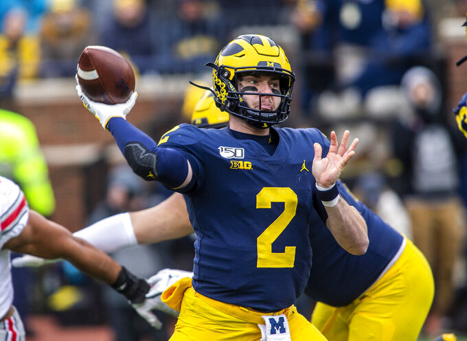 FILE - In this Nov. 30, 2019, file photo, Michigan quarterback Shea Patterson (2) throws a pass in the first quarter of the team' NCAA college football game against Ohio State in Ann Arbor, Mich. Patterson has agreed to terms with the Kansas City Chiefs as an undrafted free agent. Agent Bryan Ehrlich confirmed the deal Sunday, May 3, 2020. Patterson started all 26 games for the Wolverines over the past two seasons after transferring from Mississippi. (AP Photo/Tony Ding, File)