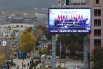 A giant TV screen shows an image of East Asia leaders to promote upcoming the South Korea-ASEAN special summit in Seoul, South Korea, Thursday, Nov. 21, 2019. North Korea says leader Kim Jong Un turned down an invitation by South Korean President Moon Jae-in to participate in a regional summit next week in the southern city of Busan and has blamed the South for a deep freeze in inter-Korean relations. The sign reads