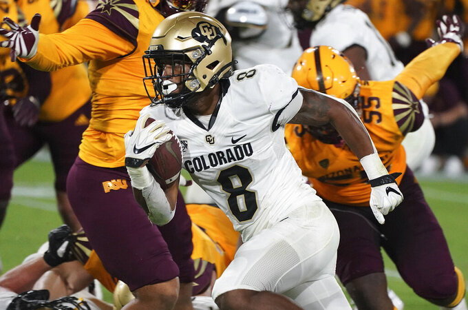 Colorado tailback Alex Fontenot (8) finds running room against Arizona State's defense during the second half of an NCAA college football game Saturday, Sept. 25, 2021, in Tempe, Ariz. (AP Photo/Darryl Webb)