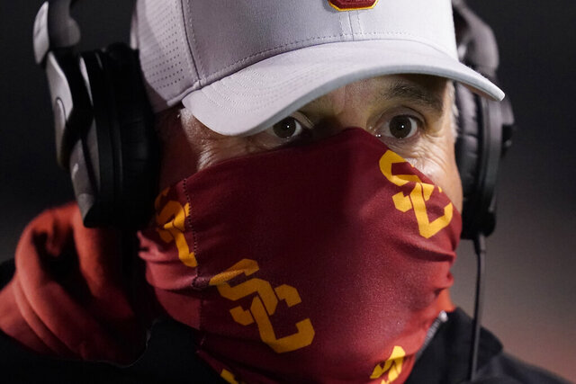Southern California head coach Clay Helton looks on following an NCAA college football game against Utah Sunday, Nov. 22, 2020, in Salt Lake City. (AP Photo/Rick Bowmer)