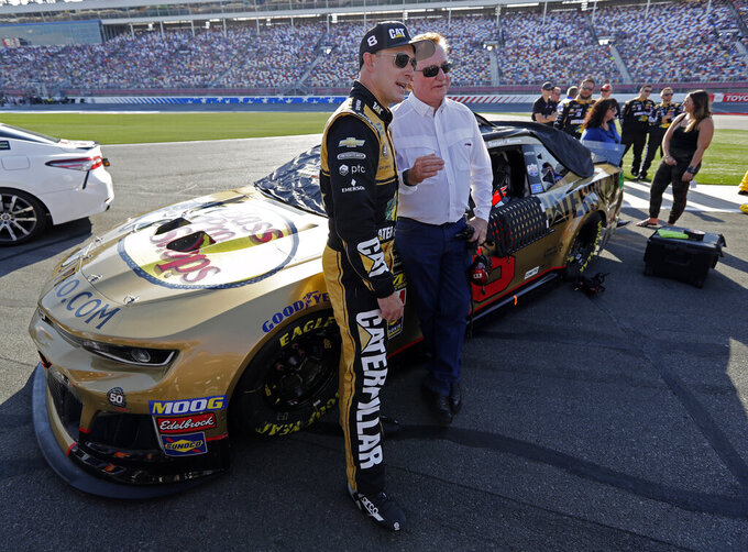Team owner Richard Childress, right, talks with Daniel Hemric before the NASCAR All-Star Open auto race at Charlotte Motor Speedway in Concord, N.C., Saturday, May 18, 2019. (AP Photo/Chuck Burton)
