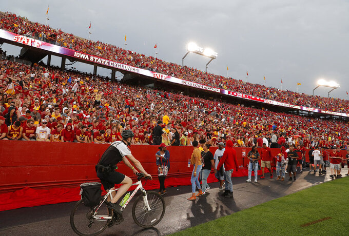 Fans are asked to leave the stadium after lightning was spotted as Iowas State takes on South Dakota State in an NCAA college football game, Saturday, Sept. 1, 2018, in Ames, Iowa. (AP Photo/Matthew Putney)