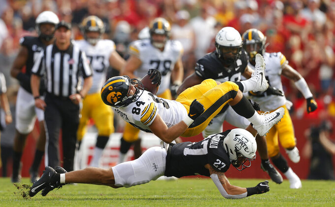 Iowa State defensive back Craig McDonald (27) upends Iowa tight end Sam LaPorta (84) during the first half of an NCAA college football game, Saturday, Sept. 11, 2021, in Ames, Iowa. (AP Photo/Matthew Putney)