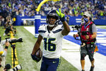 Seattle Seahawks wide receiver Tyler Lockett (16) celebrates after a touchdown against the Indianapolis Colts in the first half of an NFL football game in Indianapolis, Sunday, Sept. 12, 2021. (AP Photo/Charlie Neibergall)