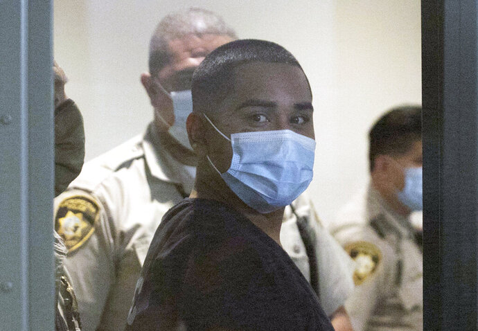 Edgar Samaniego, charged in the shooting of Metro Police Officer Shay Mikalonis, appears at the Regional Justice Center on Wednesday, June 3, 2020, in Las Vegas.  Samaniego is accused of shooting and critically injuring Mikalonis on the Las Vegas Strip Monday, during a protest against police brutality sparked by the death of George Floyd, a black man who died after being restrained by Minneapolis  police officers on May 25.  (Bizuayehu Tesfaye/Las Vegas Review-Journal via AP)