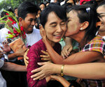 FILE - In this July 7, 2019, file photo, one of the villagers welcoming Myanmar democracy icon Aung San Suu Kyi kisses her as she visits Nyaung Oo market in Nyaung U village, Myanmar. There was a time when Suu Kyi was the hero of the human rights set, whose nonviolent struggle against her country's military dictatorship was admired by people around the world and won her the Nobel Peace Prize in 1991. Now she is seen by many of her admirers as an apologist for war crimes against its Muslim Rohingya minority. (AP Photo/Khin Maung Win)