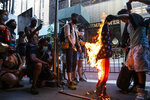Protesters burn U.S. flags during a protest in front of Trump Tower, Saturday, July 4, 2020, in New York.(AP Photo/Eduardo Munoz Alvarez)