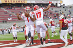 Louisiana-Lafayette quarterback Levi Lewis (1) celebrates a touchdown with wide receiver Dontae Fleming (17) during the first half of an NCAA college football game against Louisiana-Monroe in Monroe, La., Saturday, Nov. 28, 2020. (AP Photo/Matthew Hinton)