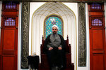 Shaykh Amir Mukhtar Faezi, the founder of Ahl Al-Bayt Islamic Seminary, poses for a portrait in the prayer area of the mosque in Streamwood, Ill., on Oct. 30, 2019. The U.S.-based seminary is focused on the Shiite tradition. Faezi founded it in 2014, offering a five-year graduate program. (AP Photo/Noreen Nasir)