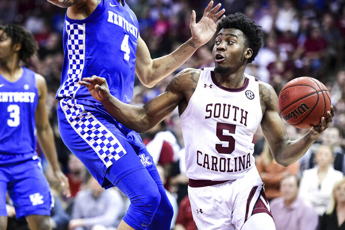 South Carolina guard Jermaine Couisnard (5) drives to the basketba against Kentucky forward Nick Richards (4) during the second half an NCAA college basketball game Wednesday, Jan. 15, 2020, in Columbia, S.C. South Carolina won  81-78. (AP Photo/Sean Rayford)