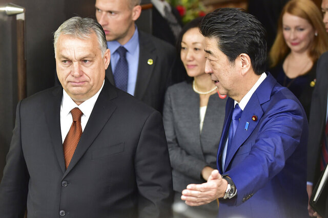 Japan's Prime Minister Shinzo Abe, right, escorts Hungary's Prime Minister Viktor Orban prior to their meeting at his office Friday, Dec. 6, 2019, in Tokyo. (Photo by Kazuhiro Nogi/Pool Photo via AP)