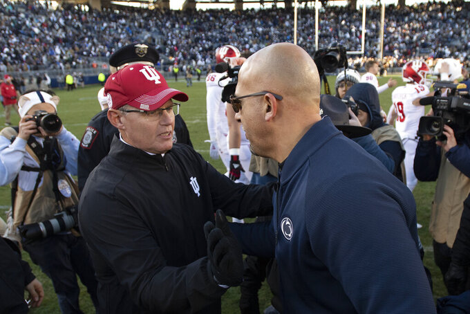 Indiana head coach Tom Allen, left, greets Penn State head coach James Franklin following their NCAA college football game in State College, Pa., on Saturday, Nov. 16, 2019. Penn State won 34-27. (AP Photo/Barry Reeger)
