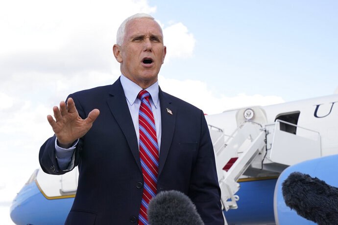 Vice President Mike Pence speaks to members of the media at Andrews Air Force Base, Md., Monday, Oct. 5, 2020, as he leaves Washington for Utah ahead of the vice presidential debate schedule for Oct. 7. (AP Photo/Jacquelyn Martin)