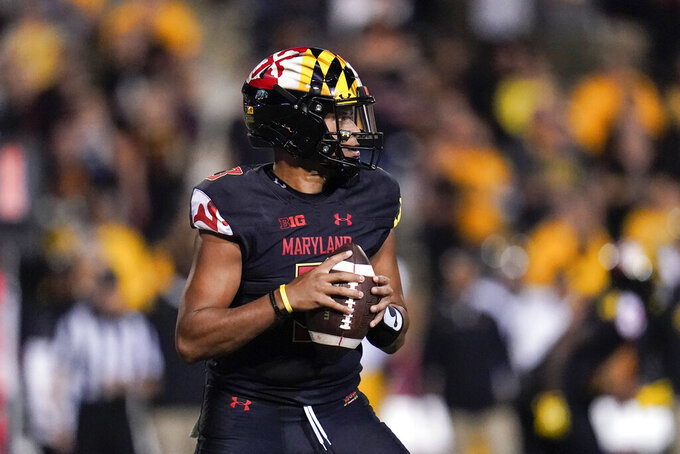 Maryland quarterback Taulia Tagovailoa looks to pass against Iowa during the first half of an NCAA college football game, Friday, Oct. 1, 2021, in College Park, Md. (AP Photo/Julio Cortez)