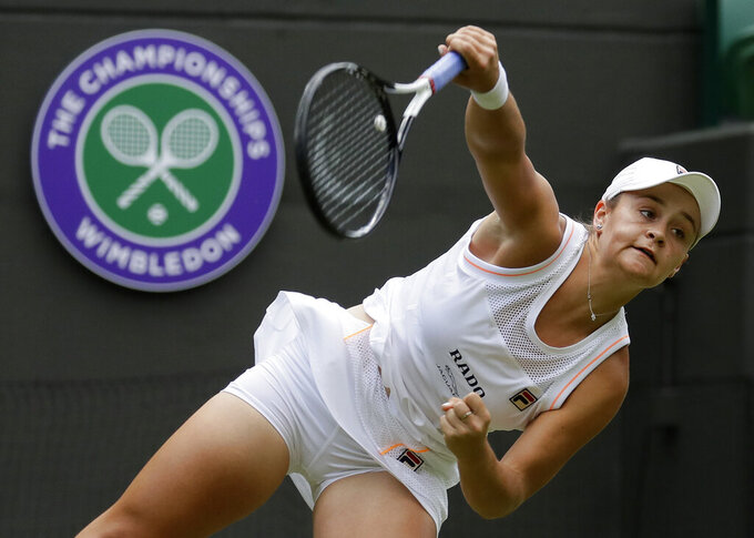 FILE - Australia's Ashleigh Barty serves to China's Saisai Zheng in their women's singles match during day two of the Wimbledon Tennis Championships in London, in this Tuesday, July 2, 2019, file photo. Barty is expected to compete in the Wimbledon tennis tournament that begins on Monday, June 28, 2021. (AP Photo/Kirsty Wigglesworth, File)