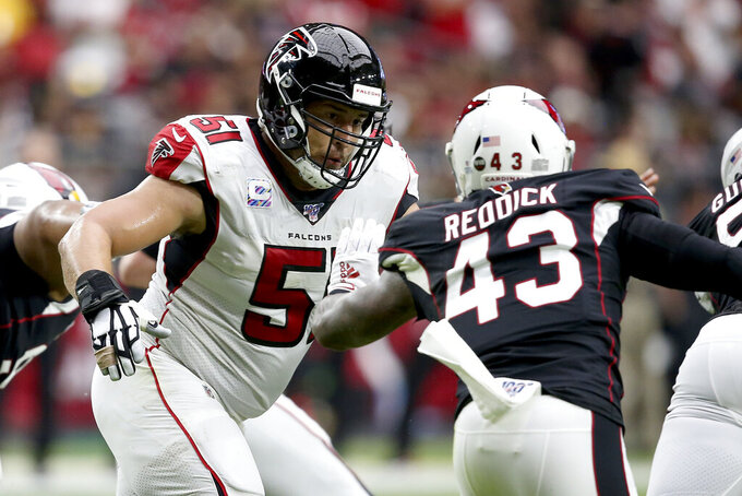 Atlanta Falcons center Alex Mack (51) battles against Arizona Cardinals outside linebacker Haason Reddick (43) during the first half of an NFL football game, Sunday, Oct. 13, 2019, in Glendale, Ariz. (AP Photo/Ross D. Franklin)