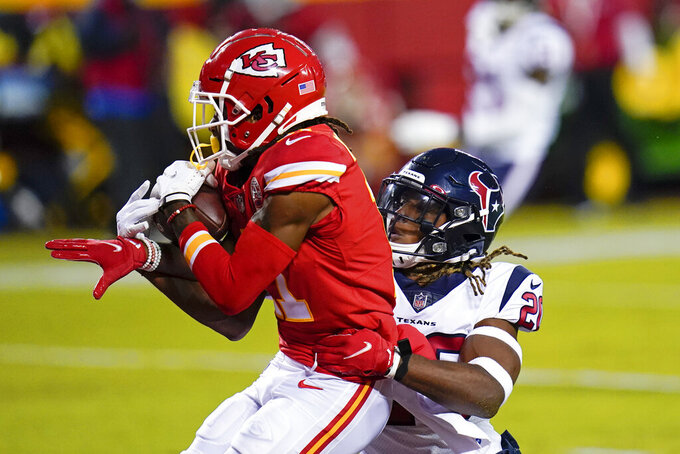 Kansas City Chiefs wide receiver Demarcus Robinson (11) reaches for a pass as he is defended by Houston Texans safety Justin Reid (20) in the end zone in the first half of an NFL football game Thursday, Sept. 10, 2020, in Kansas City, Mo. The play was ruled an incomplete pass. (AP Photo/Jeff Roberson)