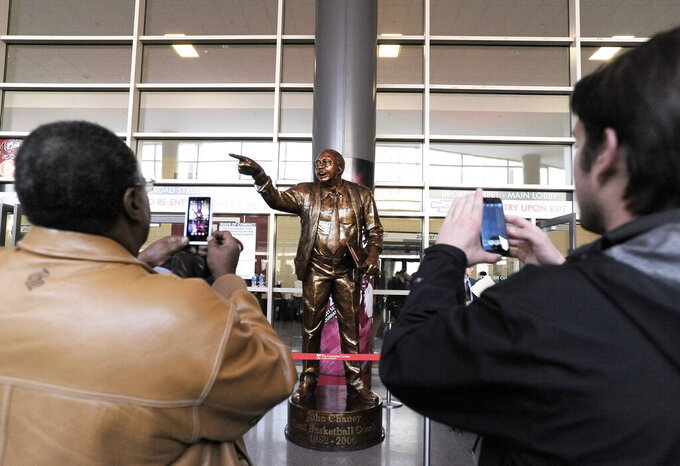FILE - A statue of former Temple coach John Chaney is unveiled before the start of an NCAA college basketball game against Villanova in Philadelphia, in this Saturday, Feb. 1, 2014, file photo. John Chaney, one of the nation's leading Black coaches and a commanding figure during a Hall of Fame basketball career at Temple, has died. He was 89. His death was announced by the university Friday, Jan. 29, 2021.(AP Photo/Michael Perez, File)