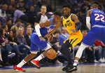 Sacramento Kings guard Buddy Hield, left, uses a screens by  Richaun Holmes, right, as he tries to leave Utah Jazz guard Donovan Mitchell behind during the first quarter of an NBA basketball game in Sacramento, Calif., Friday, Nov. 1, 2019. (AP Photo/Rich Pedroncelli)