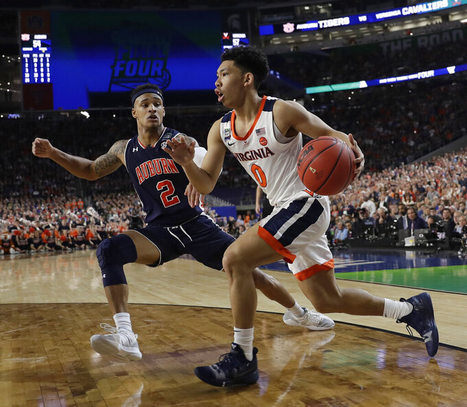 Virginia's Kihei Clark (0) drives against Auburn's Bryce Brown (2) during the second half in the semifinals of the Final Four NCAA college basketball tournament, Saturday, April 6, 2019, in Minneapolis. (AP Photo/David J. Phillip)