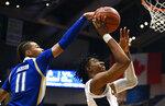 Tulsa's Darien Jackson, left, blocks a shot-attempt by Connecticut's Isaiah Whaley, right, in the first half of an NCAA college basketball game, Sunday, Jan. 26, 2020, in Hartford, Conn. (AP Photo/Jessica Hill)