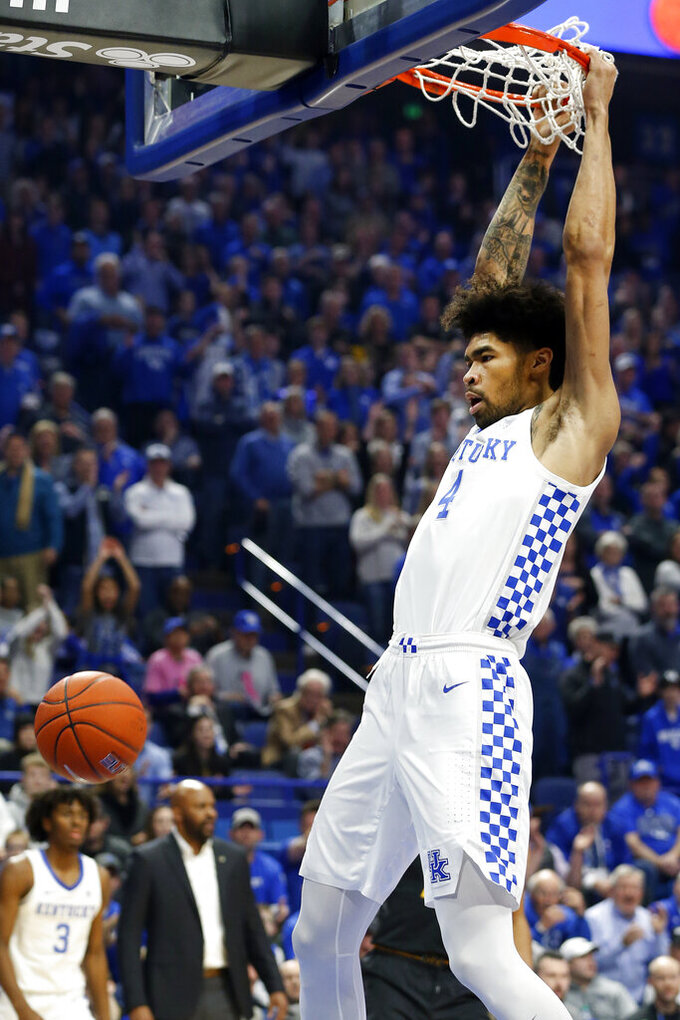 Kentucky's Nick Richards dunks during the first half of an NCAA college basketball game against Missouri in Lexington, Ky., Saturday, Jan 4, 2020. (AP Photo/James Crisp)