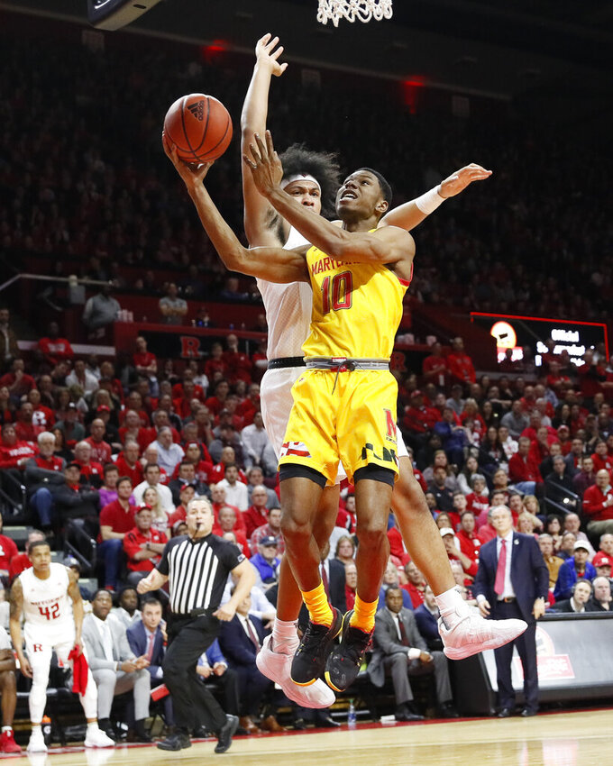 Maryland's Serrel Smith Jr. (10) shoots against Rutgers' Ron Harper Jr. (24) during the first half of an NCAA college basketball game Tuesday, March 3, 2020, in Piscataway, N.J. (AP Photo/John Minchillo)