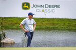 Adam Long watches golfers in his group on the 18th green before taking his putt during the first round of the John Deere Classic at TPC Deere Run in Silvis, Ill., Thursday, July 11, 2019. (Andy Abeyta/Quad City Times via AP)