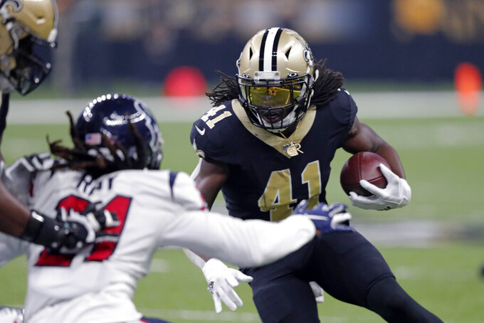 New Orleans Saints running back Alvin Kamara (41) caries against Houston Texans cornerback Bradley Roby (21) in the first half of an NFL football game in New Orleans, Monday, Sept. 9, 2019. (AP Photo/Bill Feig)