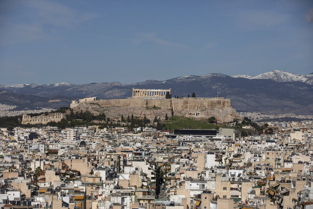 A general view of the city of Athens with the ancient Acropolis hill on the background, Tuesday Jan. 28, 2020. Greece has launched an auction for a 15-year bond, aimed at taking advantage of low interest rates and a recent sovereign credit rating upgrade. (AP Photo/Petros Giannakouris)