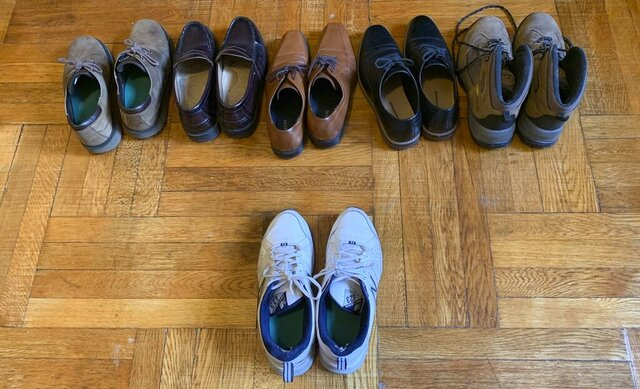Associated Press journalist Dave Clark displays the six pairs of shoes he owns in his apartment in Manhattan's Washington Heights neighborhood Wednesday, July 22, 2020, in New York, with the one pair he's worn since lockdown, caused by the coronavirus pandemic, began. (AP Photo/Dave Clark)