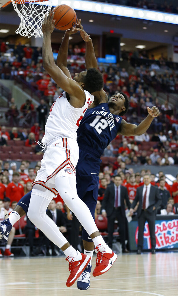 Ohio State's Andre Wesson, left, tries to shoot over Penn State's Izaiah Brockington during the second half of an NCAA college basketball game Saturday, Dec. 7, 2019, in Columbus, Ohio. Ohio State beat Penn State 104-74. (AP Photo/Jay LaPrete)