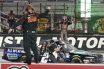 Sam Mayer, right, celebrates his win in the NASCAR Truck Series auto race Thursday,  Sept. 17, 2020, in Bristol, Tenn. (AP Photo/Steve Helber)