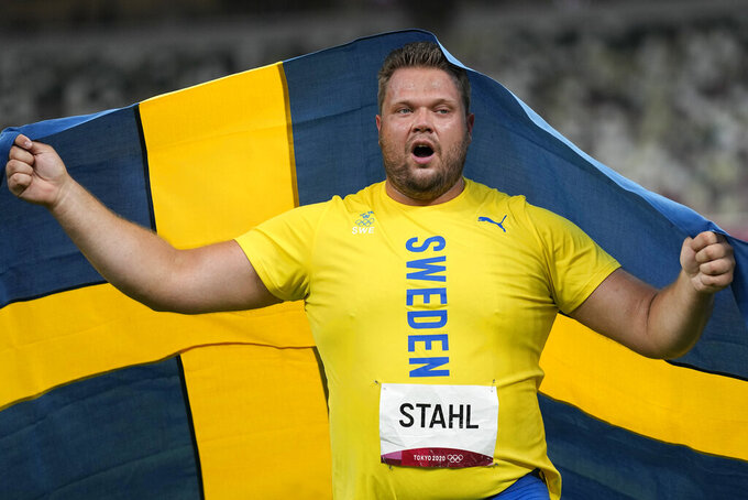 Daniel Stahl, of Sweden, celebrates after winning the final of the men's discus throw at the 2020 Summer Olympics, Saturday, July 31, 2021, in Tokyo. (AP Photo/David J. Phillip)