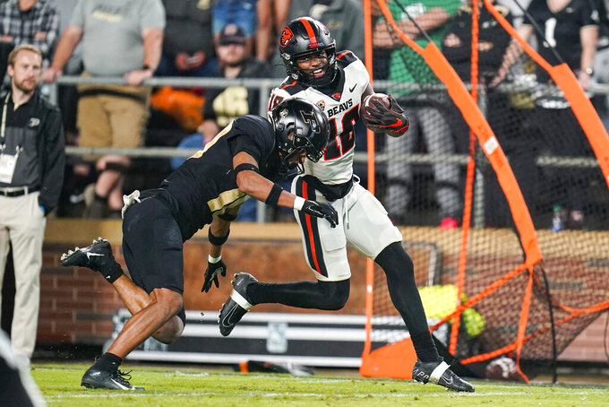 Purdue safety Cam Allen (10) tackles Oregon State wide receiver Zeriah Beason (18) during the second half of an NCAA college football game in West Lafayette, Ind., Saturday, Sept. 4, 2021. (AP Photo/Michael Conroy)